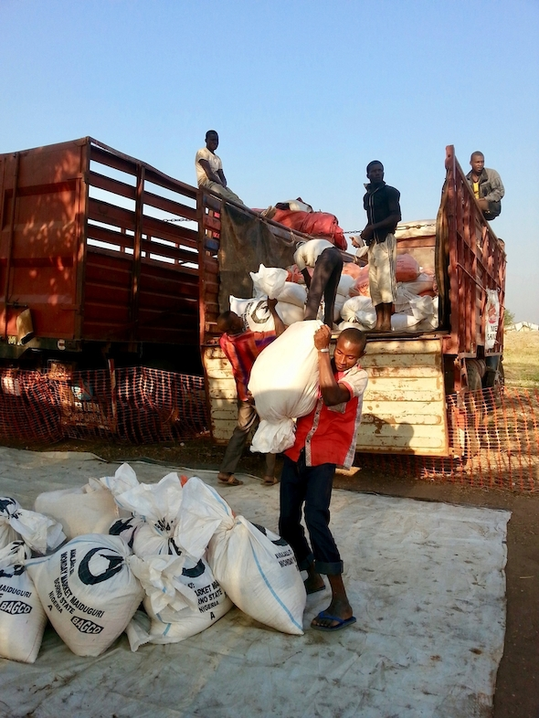MSF team unloads sacks of rice to be distributed in Kabo, northern CAR. Photographer: MSF