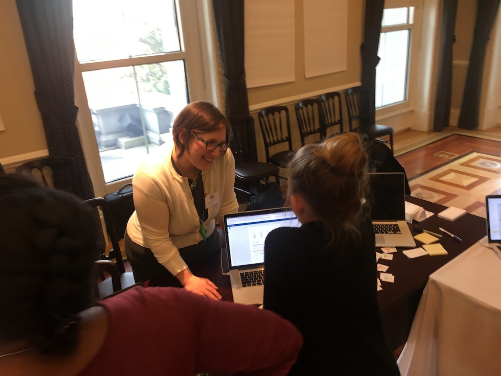 Turnitin's Stephanie Butler looks on while a student tries out Turnitin Revision Assistant at the White House Innovative Assessment Tech Jam on December 8.
