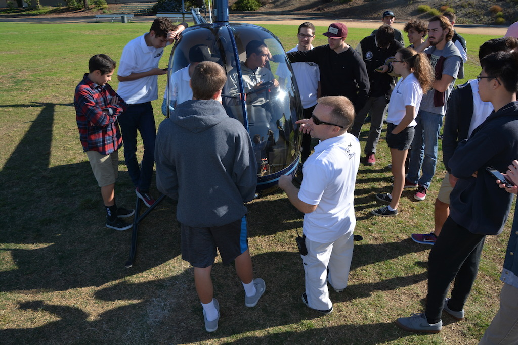 Revolution Aviation landed a helicopter on the Canyon High School field and then explained helicopters to the students while they took turns sitting in the cockpit.