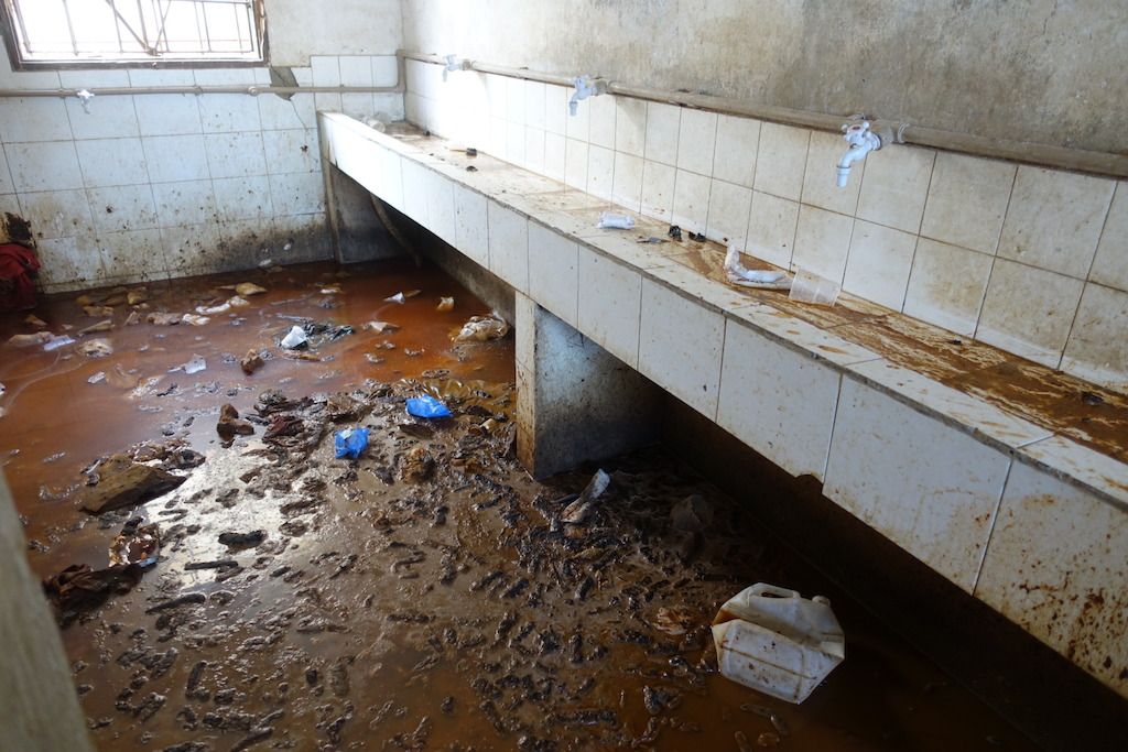 Sanitation area in a detention Center west of Misrata, ankle- deep urin and feces in the only place which inmates can use for washing and sanitation. No running water, no toilets or functioning showers at the time of visit. Photographer: Tankred Stoebe